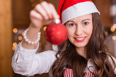 Young Girl preparing for Christmas. And holding hot tea / coffee royalty free stock photography