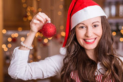 Young Girl preparing for Christmas. And holding christmas ball Stock Photo