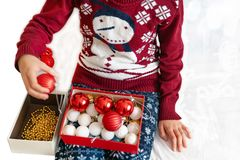 Young girl preparing christmas ornament royalty free stock images