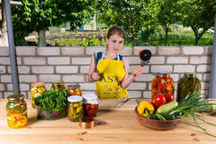 Young Girl Preparing Fresh Vegetables for Canning stock photography