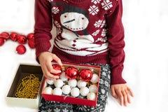 Young girl preparing christmas ornament royalty free stock image