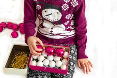 Young girl preparing christmas ornament stock images