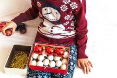 Young girl preparing christmas ornament stock photos