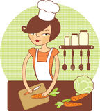 Young girl preparing salad. Young girl cutting carrot and preparing salad Royalty Free Stock Photo