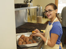 Young girl preparing sweet potatoes Royalty Free Stock Images
