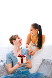 Young girl present gift to her boyfriend Royalty Free Stock Photos