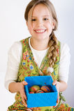 Young girl presenting a box with painted eggs Royalty Free Stock Image