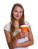Young girl presenting a cup of coffee Stock Photo