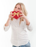 Young girl presenting a heart shaped box Royalty Free Stock Photo