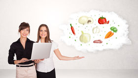 Young girl presenting nutritional cloud with vegetables Royalty Free Stock Photography