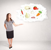 Young girl presenting nutritional cloud with vegetables Royalty Free Stock Images