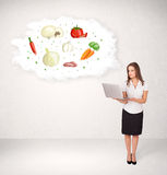Young girl presenting nutritional cloud with vegetables Stock Photo