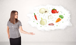 Young girl presenting nutritional cloud with vegetables Stock Image