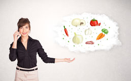 Young girl presenting nutritional cloud with vegetables Royalty Free Stock Photo