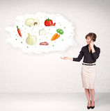 Young girl presenting nutritional cloud with vegetables Stock Images