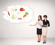Young girl presenting nutritional cloud with vegetables Royalty Free Stock Image