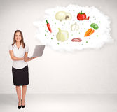Young girl presenting nutritional cloud with vegetables Royalty Free Stock Photos
