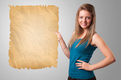 Young girl presenting old paper copy space Royalty Free Stock Photography
