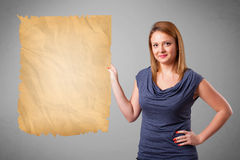 Young girl presenting old paper copy space Stock Image