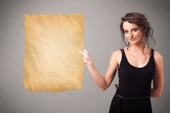 Young girl presenting old paper copy space Royalty Free Stock Photos