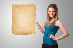 Young girl presenting old paper copy space Royalty Free Stock Image