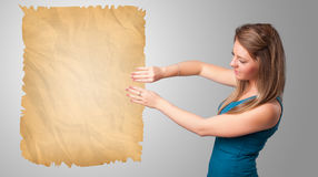 Young girl presenting old paper copy space Stock Photos