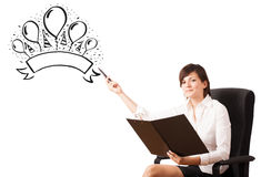 Young girl presenting a party label on whiteboard Royalty Free Stock Image