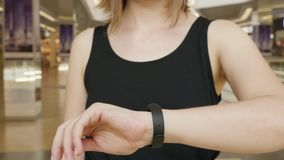 Young girl press on futuristic user interface concept bracelet. Graphical User Interface - GUI. Head up Display - HUD stock footage