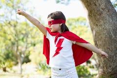 Young girl pretending to be a superhero Stock Photography