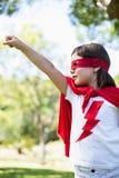 Young girl pretending to be a superhero Stock Image