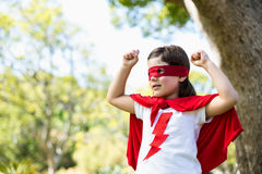 Young girl pretending to be a superhero Royalty Free Stock Photo