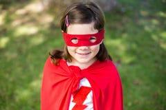Young girl pretending to be a superhero Stock Photos