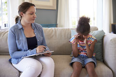 Young Girl With Problems Talking With Counselor At Home stock photos