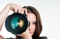 Young girl with professional camera Royalty Free Stock Photos