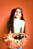 Young girl propose pizza Royalty Free Stock Photos