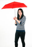 Young girl is protected from bad weather with a re Royalty Free Stock Photo