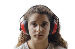 Young girl  with protective ear muffs Stock Image