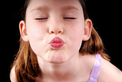 Young Girl in Pucker. Cute young girl puckering up for a kiss Stock Photos