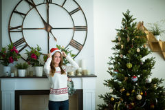Young girl pull christmas cap Royalty Free Stock Photos