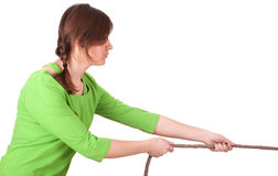 Young girl pulling grey rope, tug-of-war Royalty Free Stock Photo