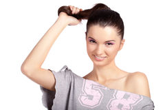 Young girl pulling her hair and smiling Stock Images