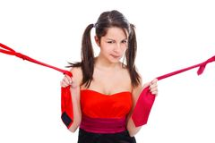 Young girl pulling ties Royalty Free Stock Images