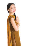 Young girl in Punjabi skirt greeting. Portrait of young mixed race Indian Chinese female in traditional punjabi dress greeting, standing isolated on white Stock Photos
