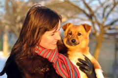 Young girl with a puppy Royalty Free Stock Photos