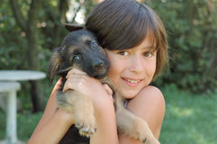 Young girl with puppy Royalty Free Stock Image