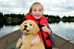 Young Girl with a Puppy on a boat Stock Photo