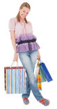 Young girl with purchases. On white background Royalty Free Stock Photo