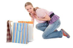 Young girl with purchases. On white background Royalty Free Stock Image