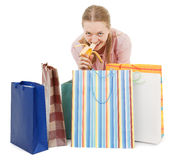 Young girl with purchases. And banana on white Royalty Free Stock Photography