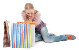 Young girl with purchases. On white background Royalty Free Stock Photos